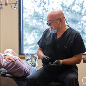 Dr. Farmer helping patient with dental anxiety